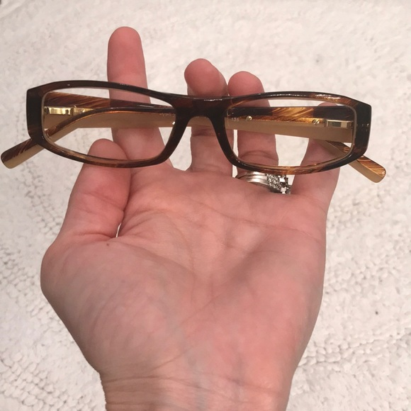 25f6ee090cbf AUTHENTIC Prada eyeglasses. M 5ba2fc21df0307fa85e6ce3b. Other Accessories  ...